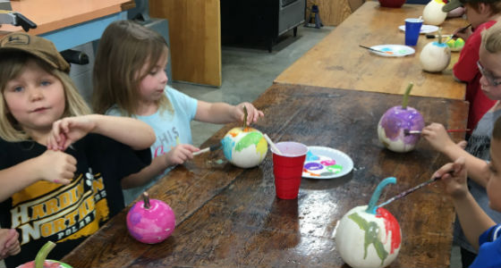 Students Painting Pumpkins